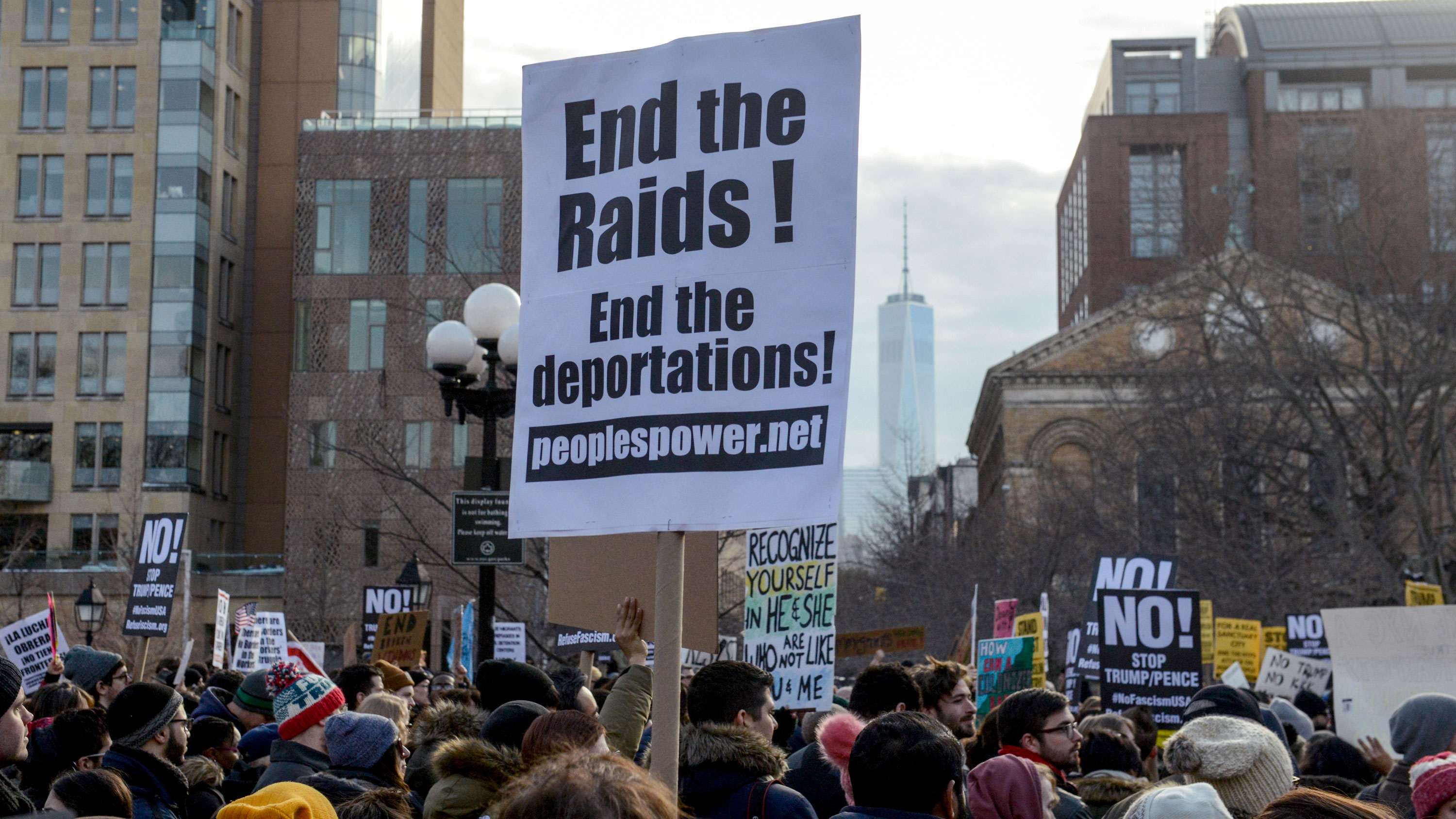 A sign at a February protest in New York City calls to end immigration raids and deportations.